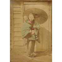 Japanese woman with child and umbrella, in front of wooden door.